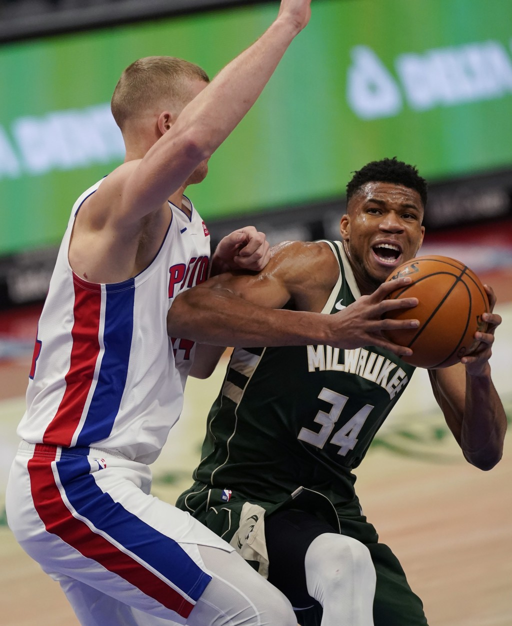 Milwaukee Bucks forward Giannis Antetokounmpo (34) is defended by Detroit Pistons center Mason Plumlee during the first half of an NBA basketball game...
