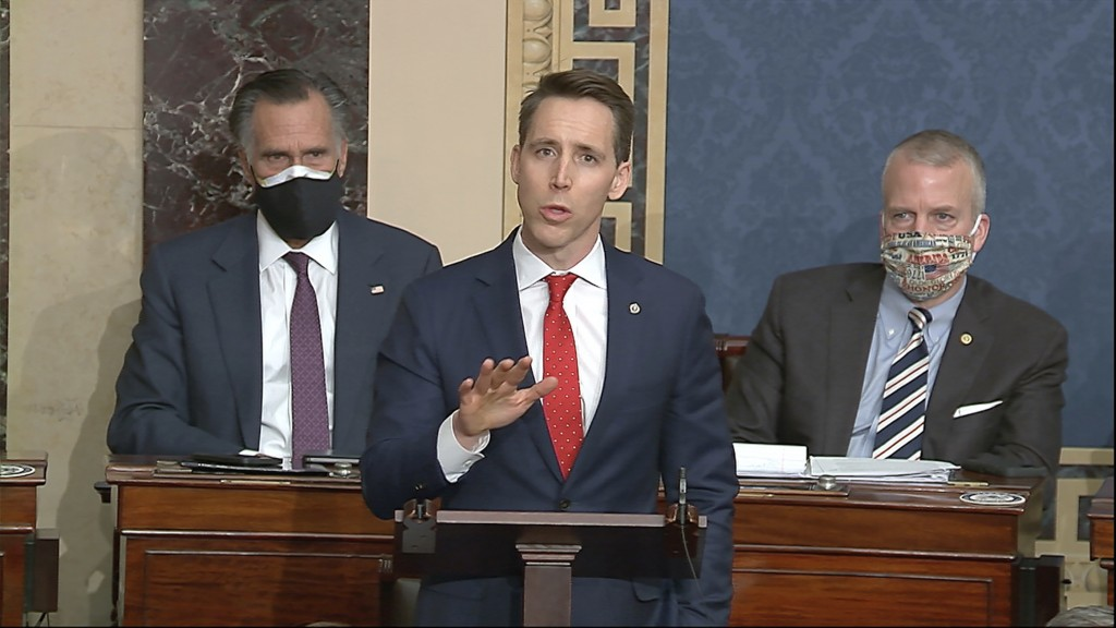 FILE - In this Jan. 6, 2021 file image from video, Sen. Josh Hawley, R-Mo., speaks at the U.S. Capitol in Washington. At least four additional compani...