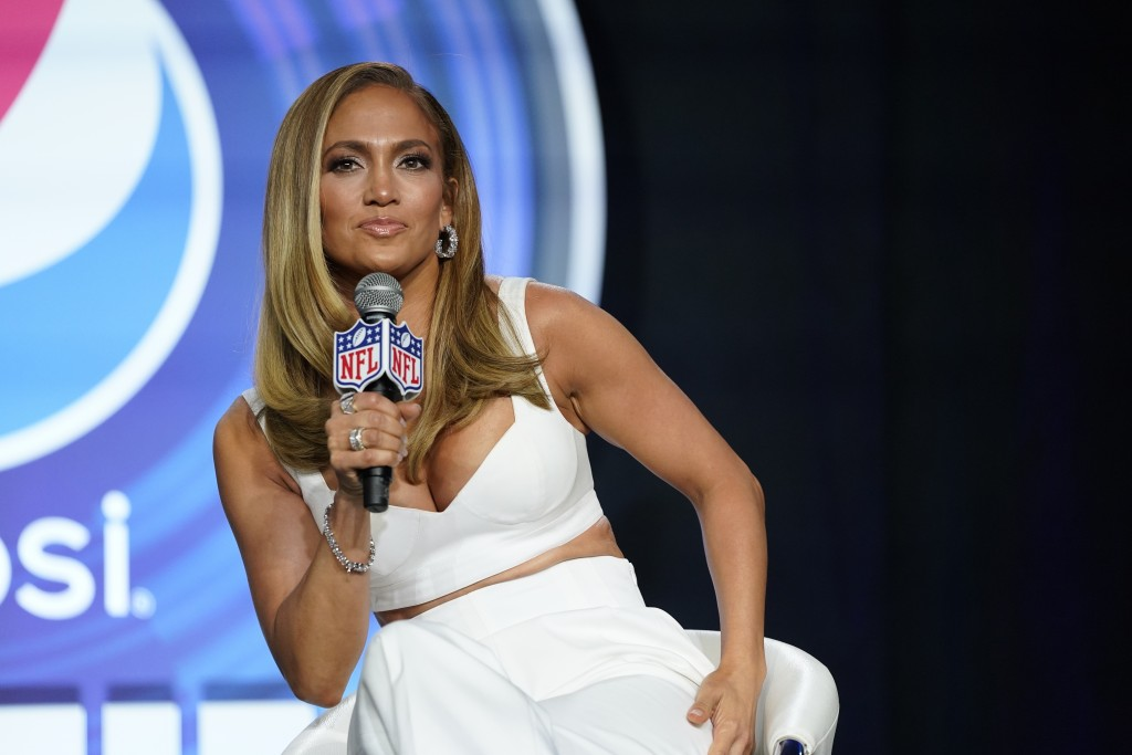 FILE - In this Jan. 30, 2020 file photo, NFL Super Bowl 54 football game halftime performer Jennifer Lopez answers questions at a news conference in M...