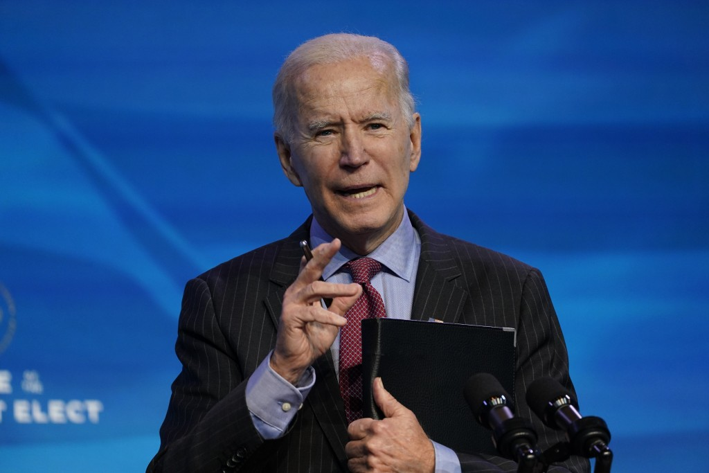 FILE - In this Jan. 8, 2021, file photo, President-elect Joe Biden speaks during an event at The Queen theater in Wilmington, Del. A coronavirus actio...