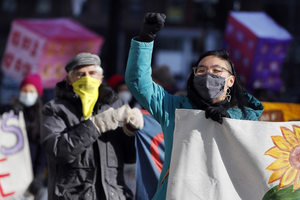 Tenants' rights advocates march from the Edward W. Brooke Courthouse, Wednesday, Jan. 13, 2021, in Boston. The protest was part of a national day of a...