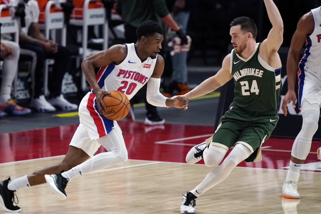 Detroit Pistons guard Josh Jackson (20) drives on Milwaukee Bucks guard Pat Connaughton (24) during the first half of an NBA basketball game, Wednesda...