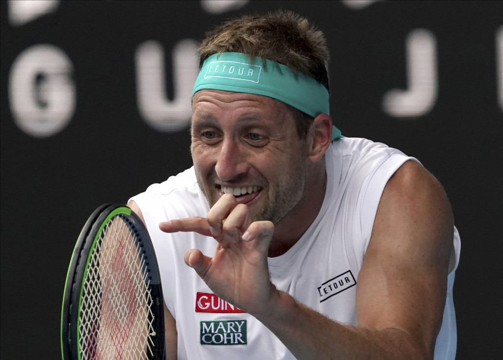 FILE - In this Jan. 28, 2020, file photo, Tennys Sandgren of the U.S. reacts after losing a point to Switzerland's Roger Federer during their quarterf...