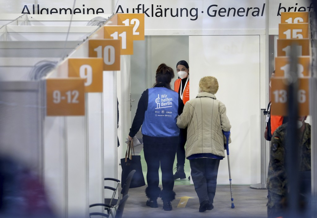 A person is guided in a new coronavirus, COVID-19, vaccination center at the 'Erika-Hess-Ice-Stadium' in Berlin, Germany, Thursday, Jan. 14, 2021. The...
