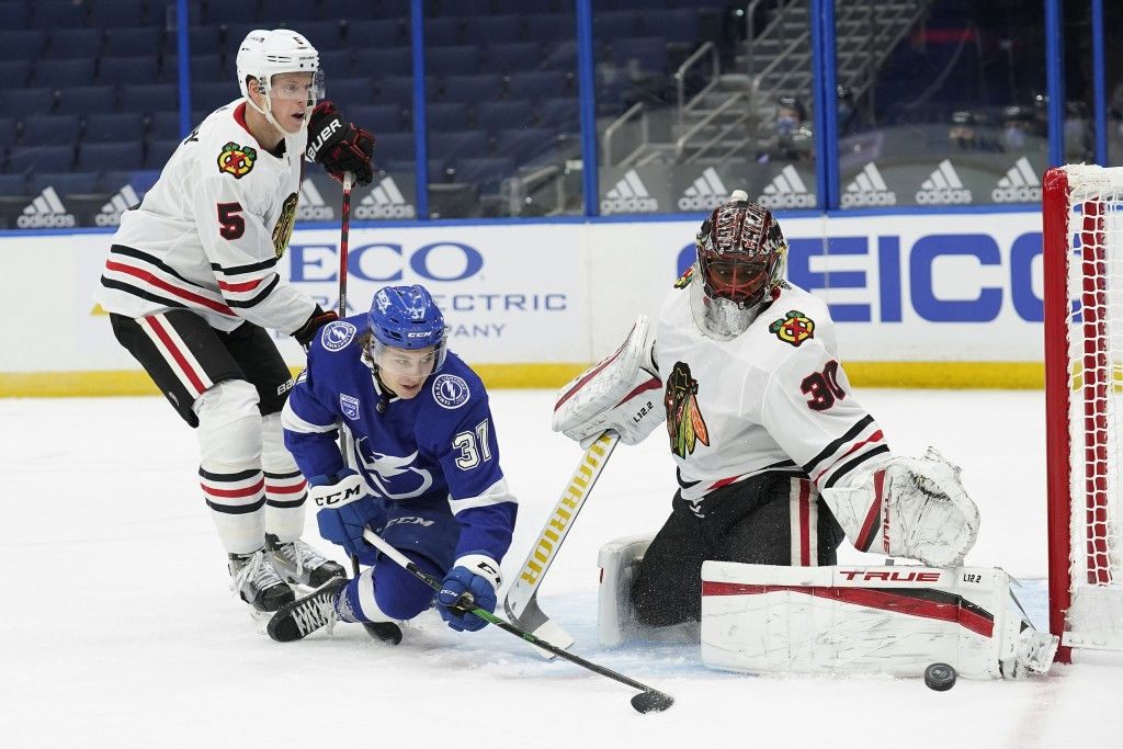 Chicago Blackhawks goaltender Malcolm Subban (30) makes a pad save on a shot by Tampa Bay Lightning center Yanni Gourde (37) during the second period ...