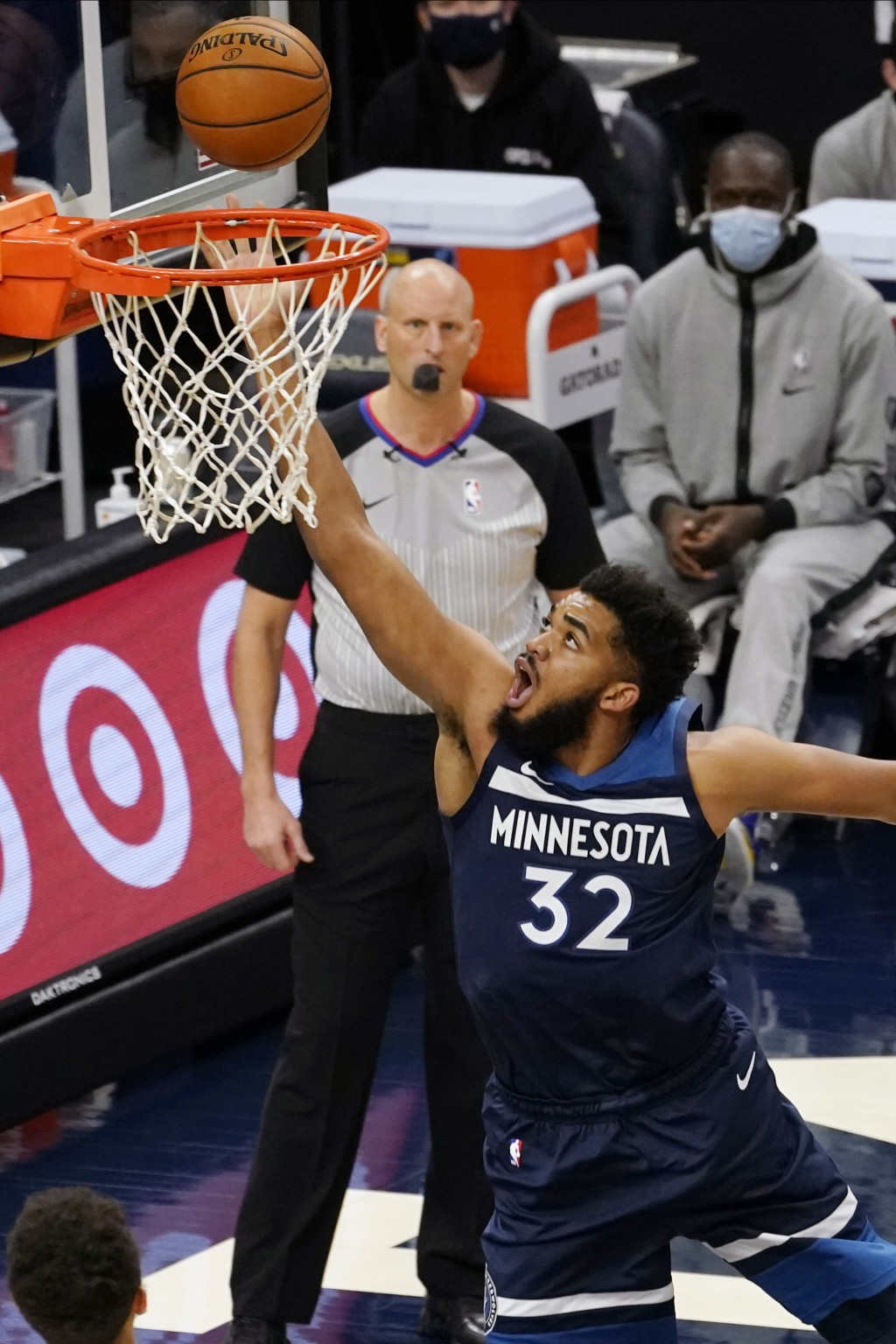 Minnesota Timberwolves' Karl-Anthony Towns (32) lays up a shot in the first half of an NBA basketball game against the Memphis Grizzlies, Wednesday, J...