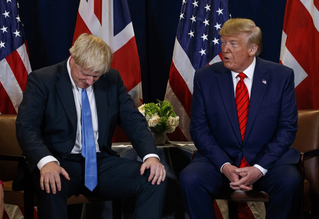 FILE - In this Tuesday, Sept. 24, 2019 file photo President Donald Trump meets with British Prime Minister Boris Johnson at the United Nations General...