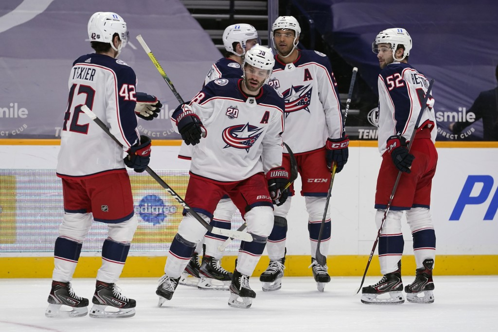 Columbus Blue Jackets center Boone Jenner (38) is congratulated after scoring against the Nashville Predators in the first period of an NHL hockey gam...