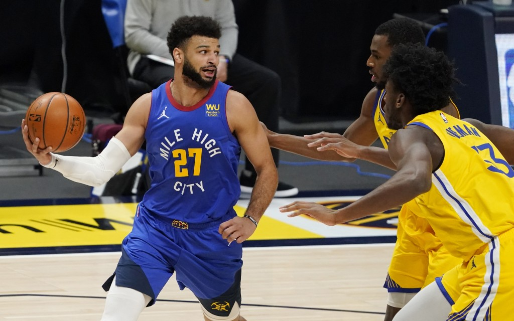 Denver Nuggets guard Jamal Murray, left, looks to pass the ball as Golden State Warriors center James Wiseman, front right, and forward Andrew Wiggins...