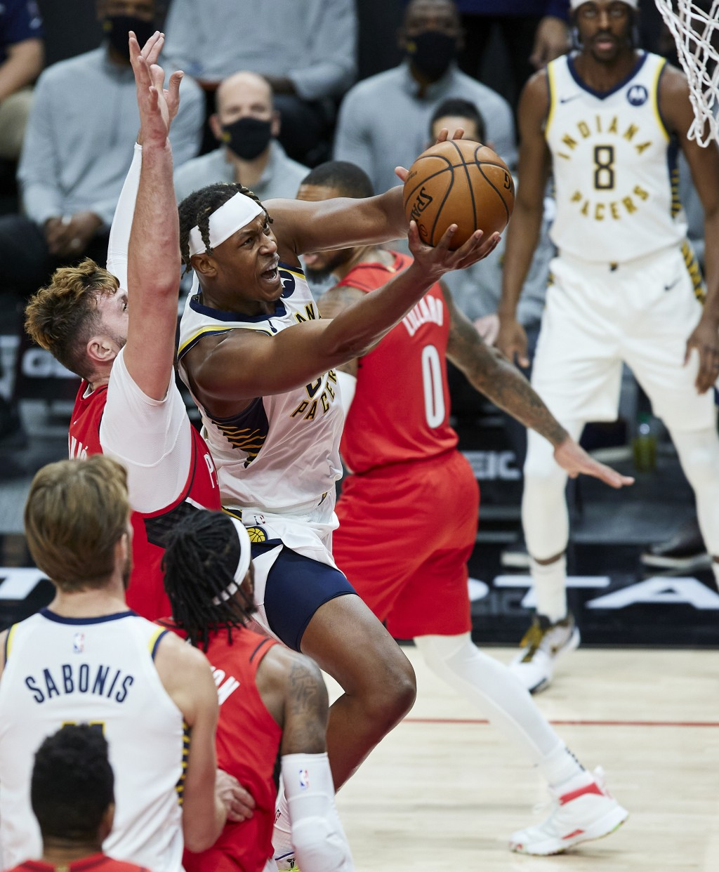Indiana Pacers center Myles Turner, right, shoots in front of Portland Trail Blazers center Jusuf Nurkic during the first half of an NBA basketball ga...