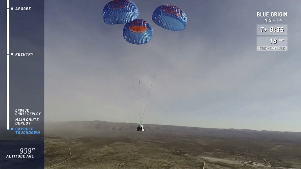 In this image from video made available by Blue Origin, the company's RSS First Step capsule uses parachutes for landing after a test flight in West T...