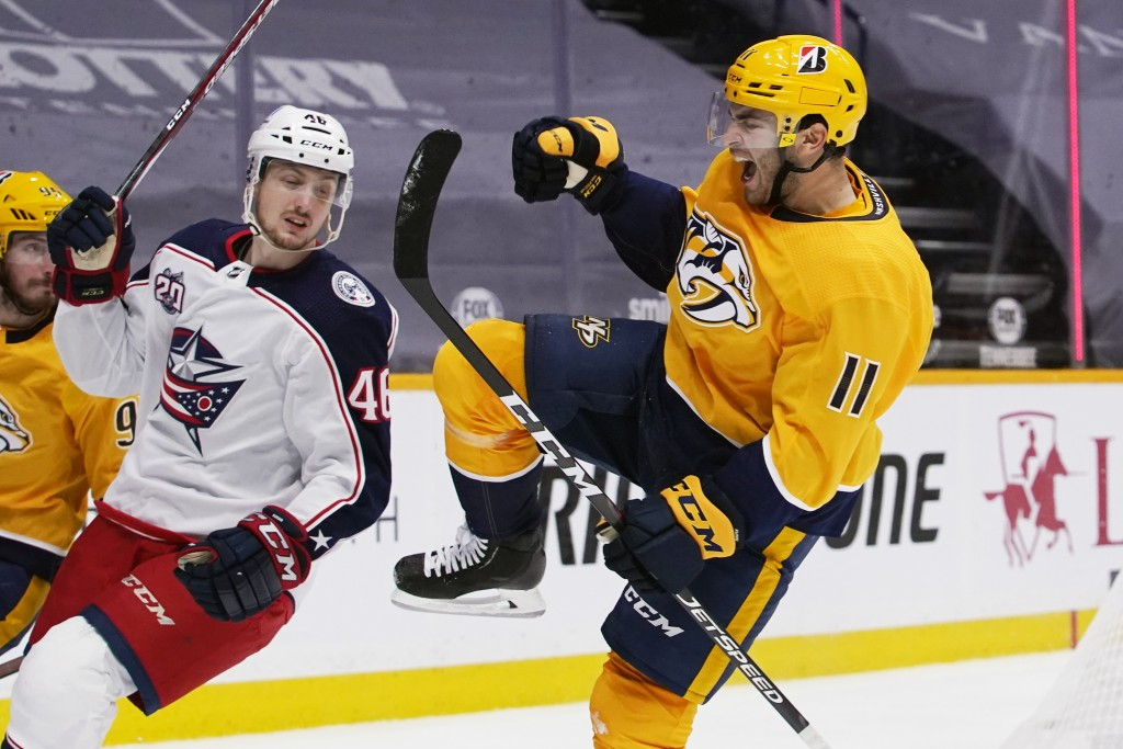 Nashville Predators center Luke Kunin (11) celebrates after scoring a goal against the Columbus Blue Jackets in the second period of an NHL hockey gam...