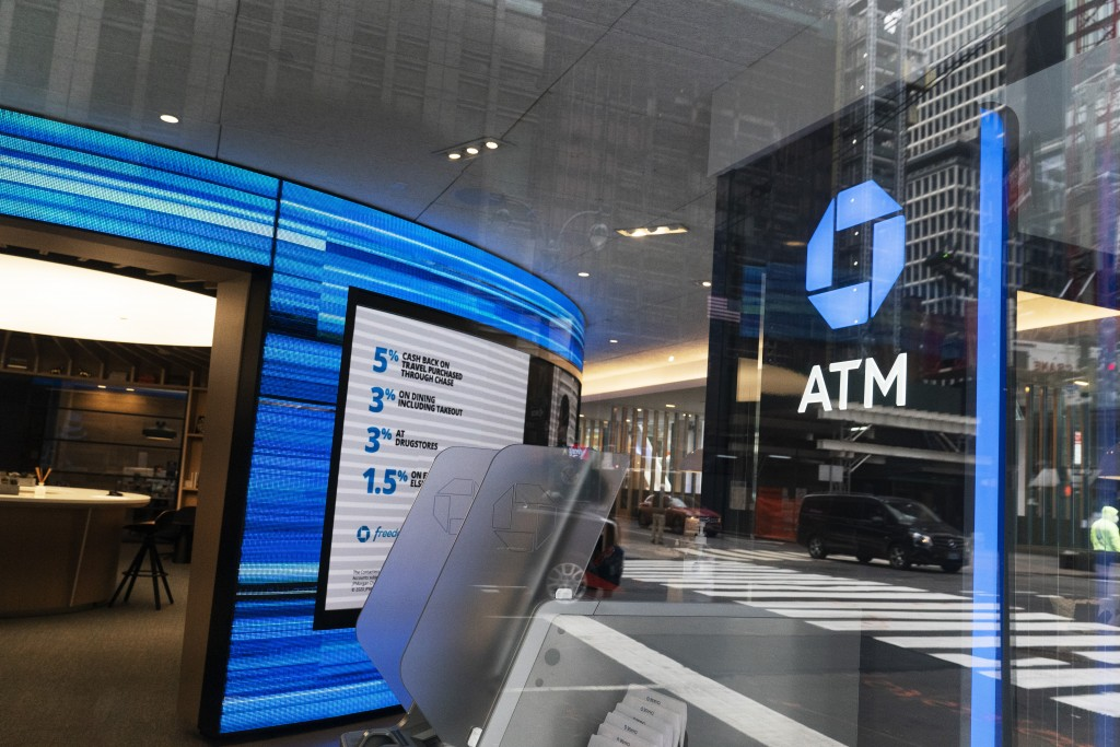 A Chase ATM is open, Wednesday, Jan. 13, 2021 in New York.  JPMorgan Chase & Co., the nation's largest bank by assets, said its fourth quarter profits...