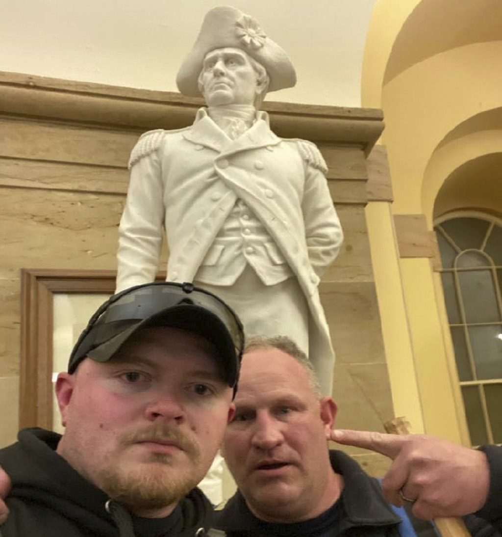 This Jan. 6, 2021 photo made available by the United States Capitol Police in a complaint and arrest warrant shows Rocky Mount Police Department Sgt. ...