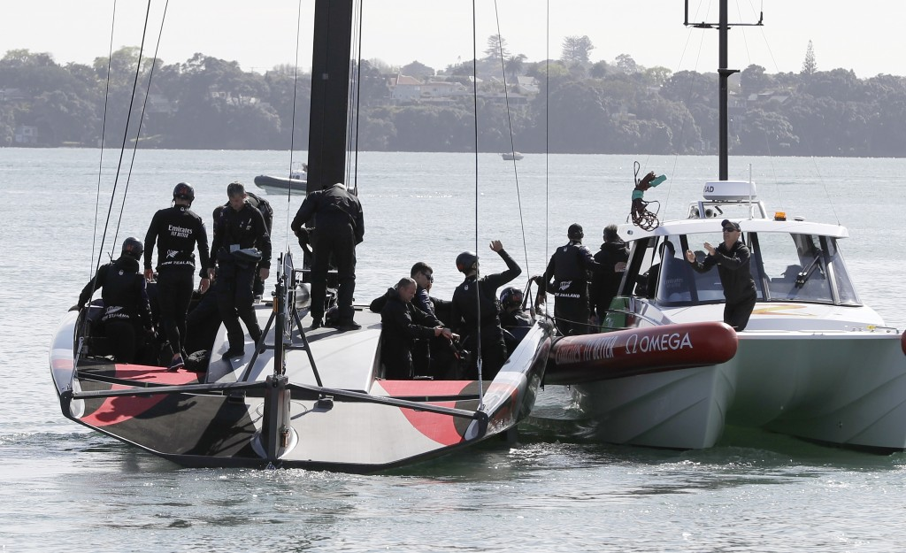 FILE - In this Sept. 18, 2019, file photo, New Zealand's America's Cup AC75 boat and crew leave their base at Auckland's Viaduct Harbour for a test sa...