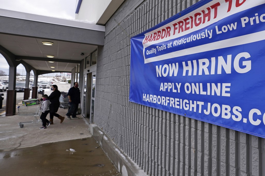 "FILE - In this Dec. 10, 2020, file photo, a ""Now Hiring"" sign hangs on the front wall of a Harbor Freight Tools store in Manchester, N.H. The latest f..."