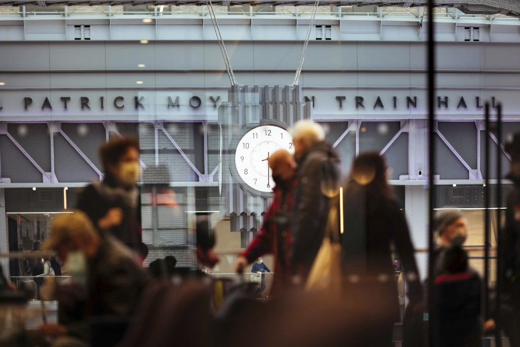 FILE - In this Jan. 1, 2021 file photo, The Amtrak Metropolitan Lounge overlooks the newly-completed Moynihan Train Hall in New York. Two major railro...