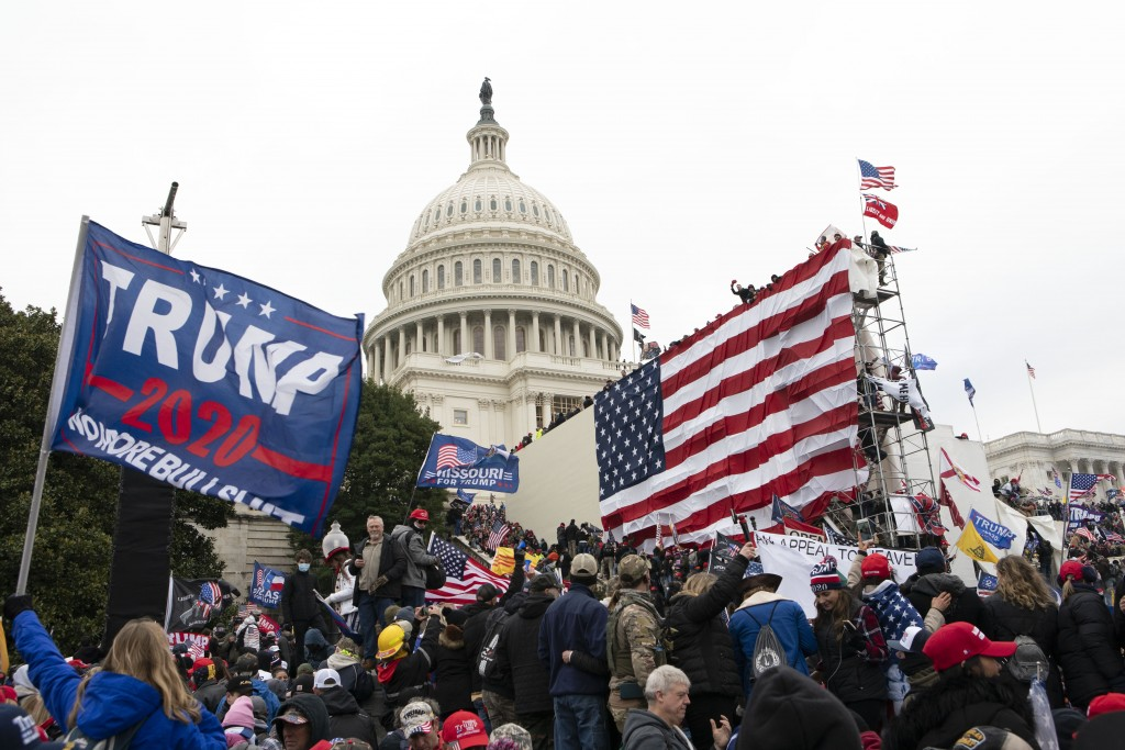 FILE - In this Jan. 6, 2021, file photo, supporters of President Donald Trump stand outside the U.S. Capitol in Washington. Black activists are coming...