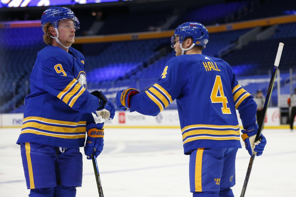 Buffalo Sabres forward Taylor Hall (4) right celebrates his goal with teammate Jack Eichel (9) during the first period of an NHL hockey game against t...