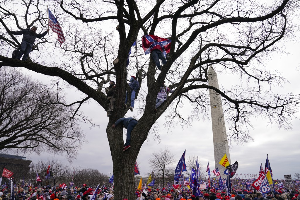 FILE - In this Wednesday, Jan. 6, 2021, file photo, supporters of President Donald Trump participate in a rally in Washington. Both within and outside...