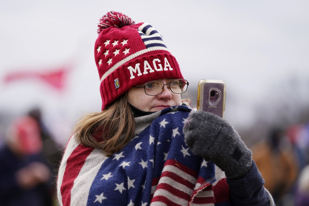 FILE - In this Jan. 6, 2021, file photo, a Trump supporter participates in a rally in Washington. Online supporters of Trump are scattering to smaller...