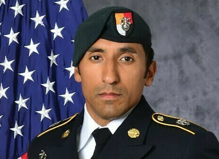 FILE - This undated photo provided by the U.S. Army shows U.S. Army Staff Sgt. Logan Melgar Green Beret, who died from non-combat related injuries in ...