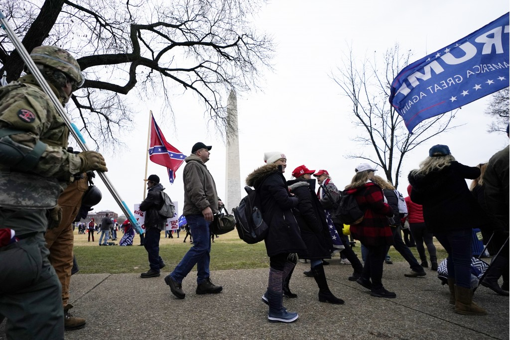 FILE - In this Jan. 6, 2021, file photo, Trump supporters gather on the Washington Monument grounds in advance of a rally in Washington. Both within a...