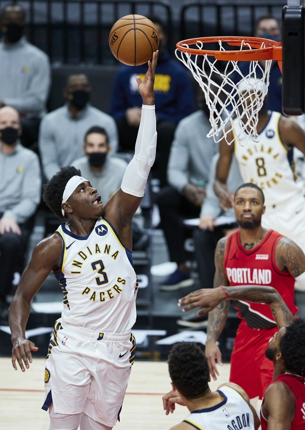 Indiana Pacers guard Aaron Holiday (3) shoots against the Portland Trail Blazers during the first half of an NBA basketball game in Portland, Ore., Th...
