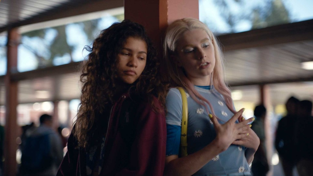 """This image released by HBO shows Zendaya, left, and Hunter Schafer in a scene from the series """"Euphoria."""" LGBTQ and gender inclusiveness on television..."""