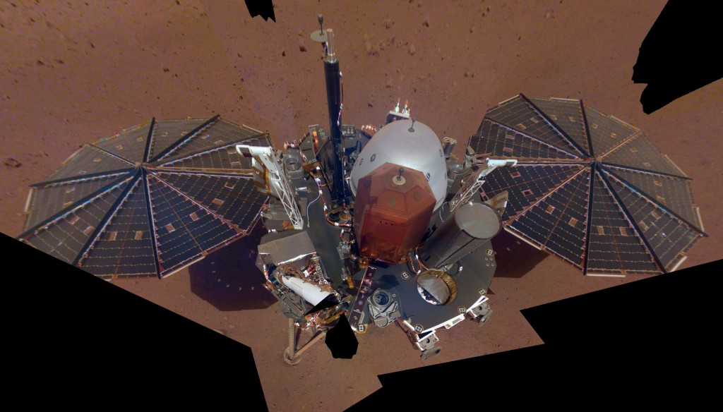 FILE - This Dec. 6, 2018 image made available by NASA shows the InSight lander. The scene was assembled from 11 photos taken using its robotic arm. On...
