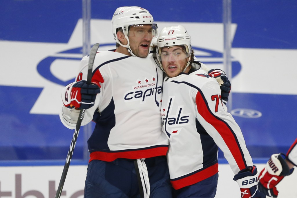 Washington Capitals forward T.J. Oshie, right, celebrates his goal with forward Alex Ovechkin, left, during the first period of an NHL hockey game aga...