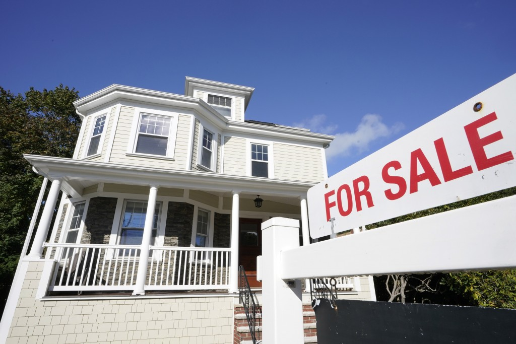 FILE - A for sale sign stands in front of a house, Tuesday, Oct. 6, 2020, in Westwood, Mass.   The long period of ultra-low rates on home loans may be...