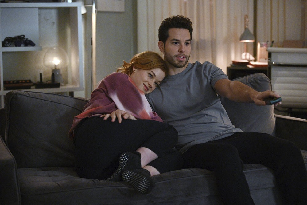 """This image released by NBC shows Jane Levy, left, and Skylar Astin in a scene from """"Zoey's Extraordinary Playlist."""" Season two of the musical series a..."""