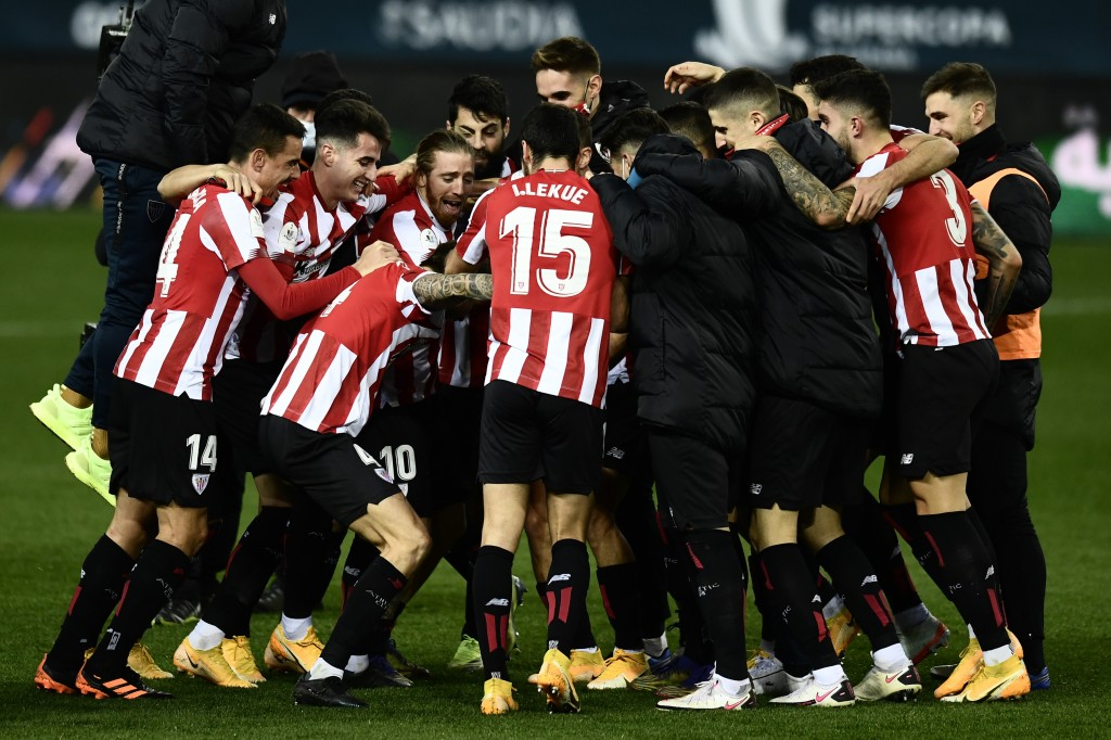 Athletic Bilbao players jubilate at the end of the Spanish Super Cup semi final soccer match between Real Madrid and Athletic Bilbao at La Rosaleda st...