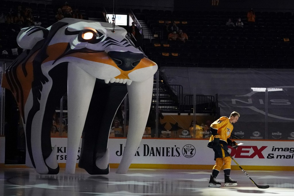 Nashville Predators left wing Cole Smith (36) is introduced before the team's season-opening NHL hockey game against the Columbus Blue Jackets Thursda...