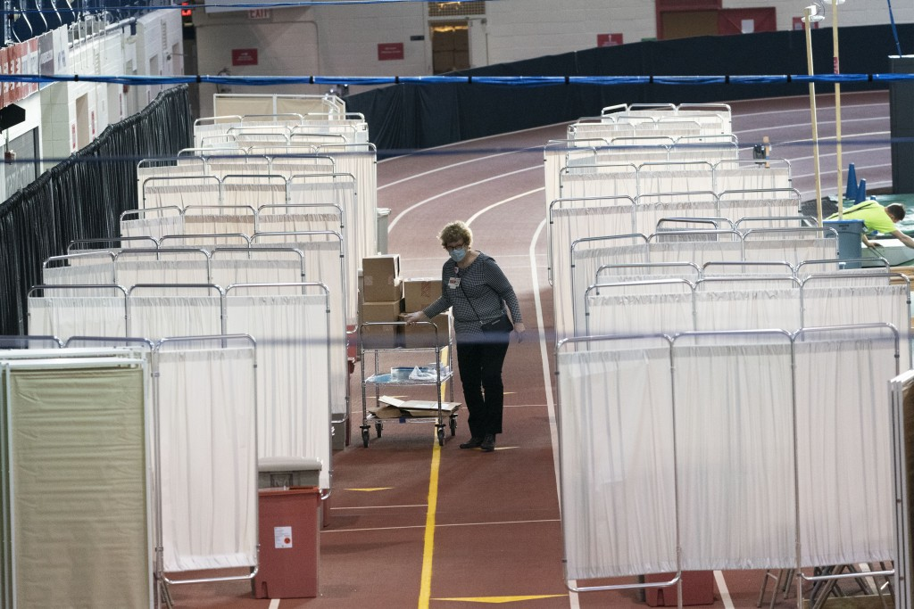The Armory, an indoor track and field complex, is being set up as a COVID-19 vaccination center, Thursday, Jan. 14, 2021, in New York. The site is run...