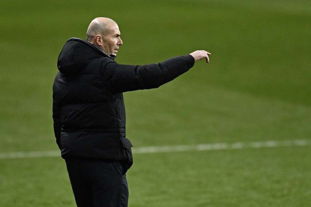Real Madrid's head coach Zinedine Zidane follows the action during Spanish Super Cup semi final soccer match between Real Madrid and Athletic Bilbao a...