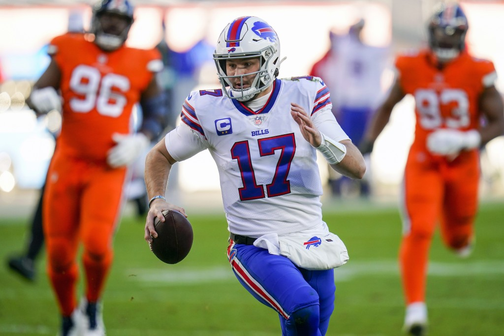 FILE - Buffalo Bills quarterback Josh Allen (17) runs against the Denver Broncos during an NFL football game in Denver, in this Saturday, Dec. 19, 202...
