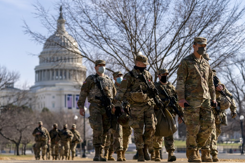 Members of the National Guard patrol outside the Capitol Building on Capitol Hill in Washington, Thursday, Jan. 14, 2021. (AP Photo/Andrew Harnik)