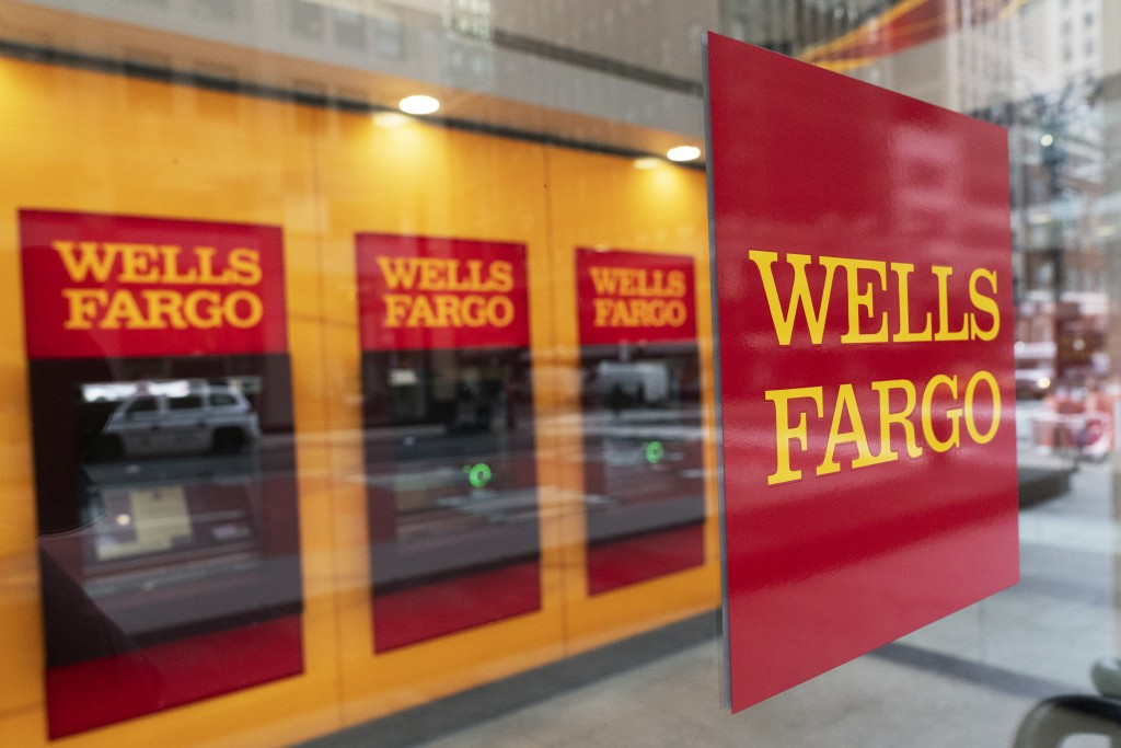 A Wells Fargo office is shown, Wednesday, Jan. 13, 2021 in New York.  Wells Fargo & Co. says its profit rose 4% to $2.99 billion in the fourth quarter...
