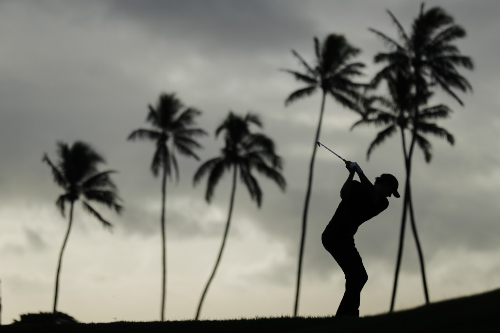 Adam Scott, of Australia, hits from the 11th tee box during the first round of the Sony Open golf tournament Thursday, Jan. 14, 2021, at Waialae Count...