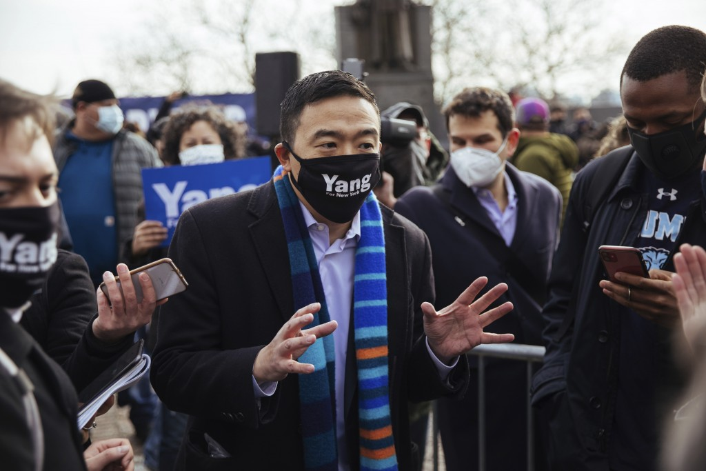 Andrew Yang takes questions from the press after he announced his run for New York City Mayor during a press conference in Morningside Park on Thursda...