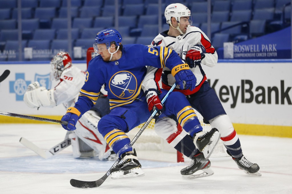 Buffalo Sabres forward Jeff Skinner (53) and Washington Capitals defenseman Justin Schultz (2) vie for position during the second period of an NHL hoc...