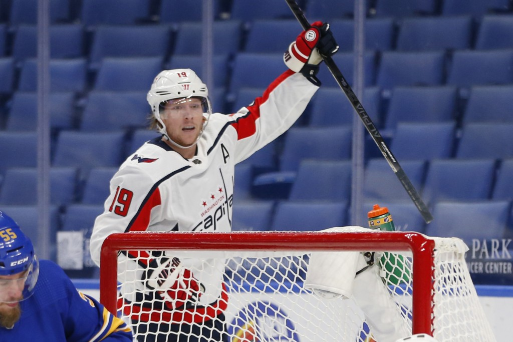 Washington Capitals forward Nicklas Backstrom (19) celebrates his goal during the first period of an NHL hockey game against the Buffalo Sabres, Thurs...