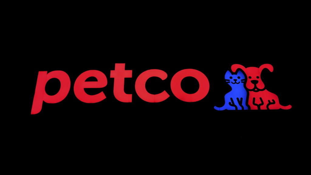 FILE - This Nov. 12, 2018 file photo hows a store sign at a Petco store in Chicago.  Petco, the San Diego-based pet store chain, went public again Thu...