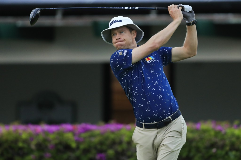 Peter Malnati follows his shot from the 10th tee box during the first round of the Sony Open golf tournament Thursday, Jan. 14, 2021, at Waialae Count...
