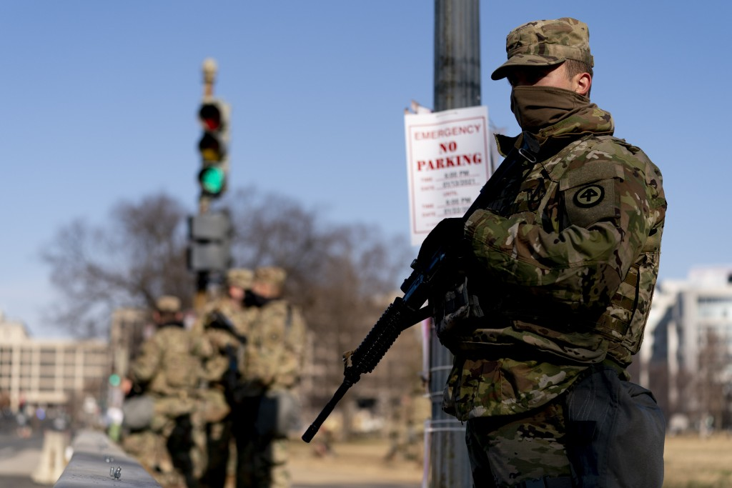Armed members of the National Guard stand guard outside the U.S. Capitol on Capitol Hill in Washington, Thursday, Jan. 14, 2021. (AP Photo/Andrew Harn...