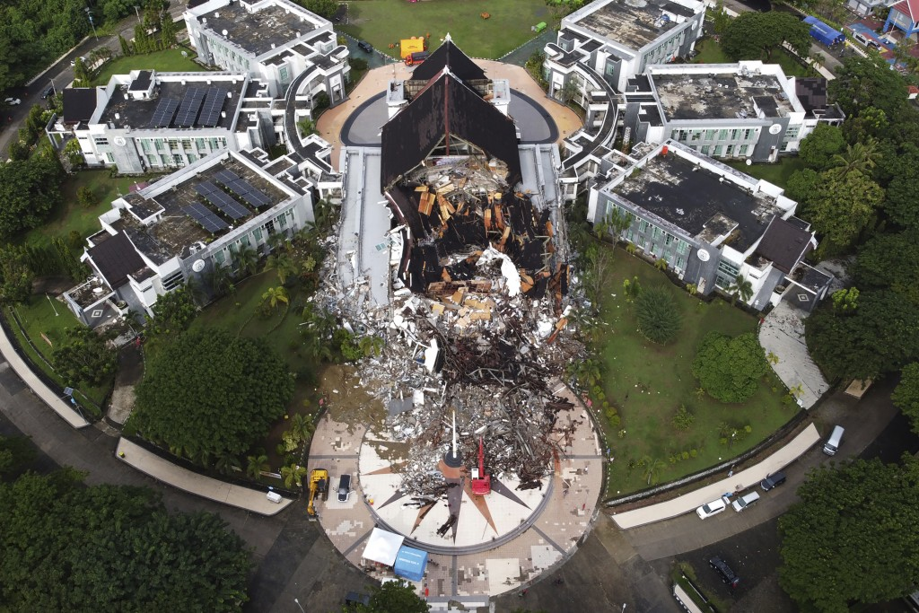 A government building is seen badly damaged following an earthquake in this aerial photo taken using a drone in Mamuju, West Sulawesi, Indonesia, Satu...