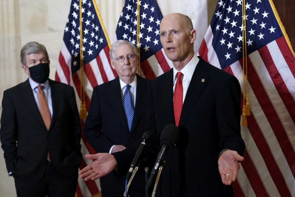 Sen. Rick Scott (right) speaks to reporters followingclosed-door meeting where Republican Conference held leadership election.