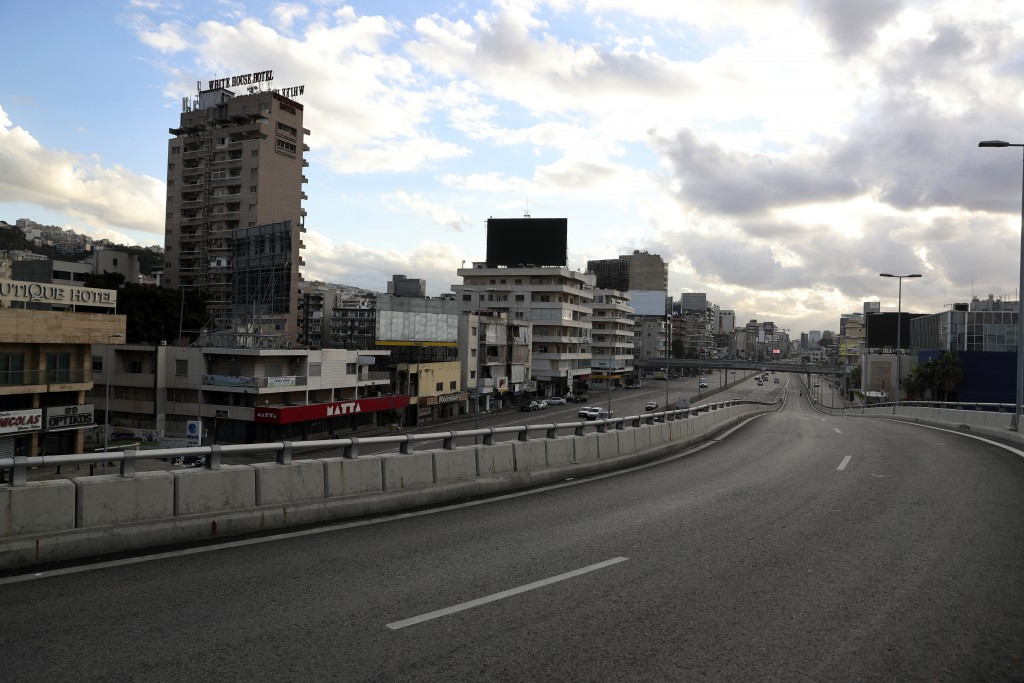 A highway is almost empty of cars during a lockdown aimed at curbing the spread of the coronavirus, in Beirut, Lebanon, Friday, Jan. 15, 2021. Lebanon...
